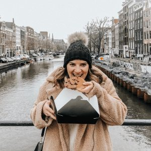 Eating stroopwafels on Amsterdam Canal